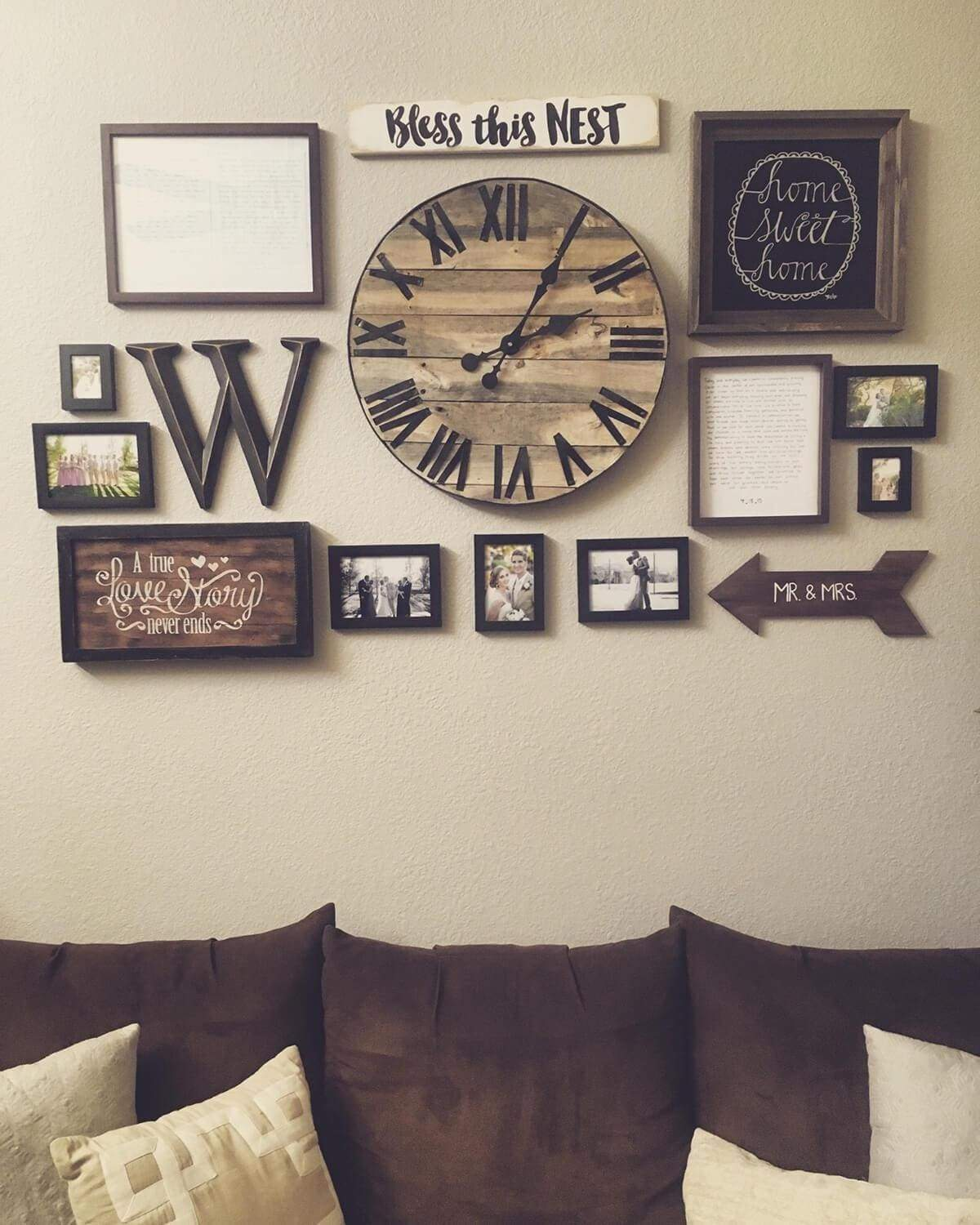 Here's that rustic clock, this 18-inch size and finish is one of our best sellers. Combine it with a grouping of small welcoming signs and family photos. While a little crowded, when grouped in a tight rectangular grouping, it makes for a neat arrangement themed in family, home, and love.