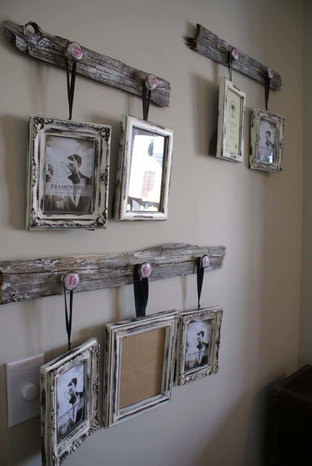 If you're looking for a very rustic look then why not create your own reclaimed wood plank hangers. Find a couple of ornate drawer pulls to accent the planks. Here is another wonderful place for a couple of our rustic barnwood picture frames, all you need is a little decorative ribbon and a couple family photos to complete this classic rustic look. Consider using black and white or sepia tone finish photos.