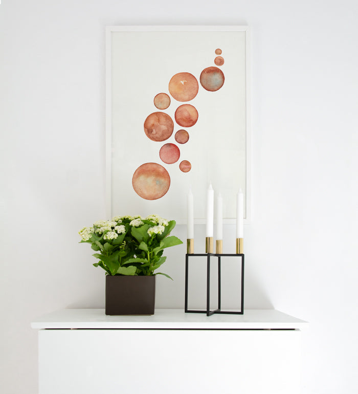 Earthy Poster decor over white dresser