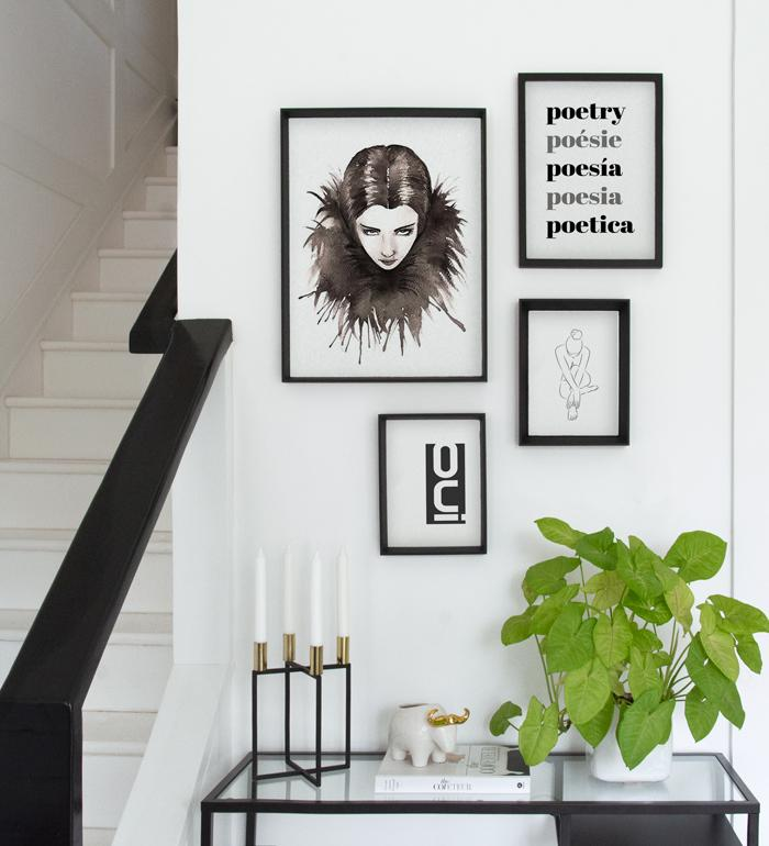 Art Gallery over console table with black and white posters