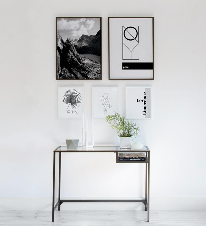 Console table with art wall in black and white