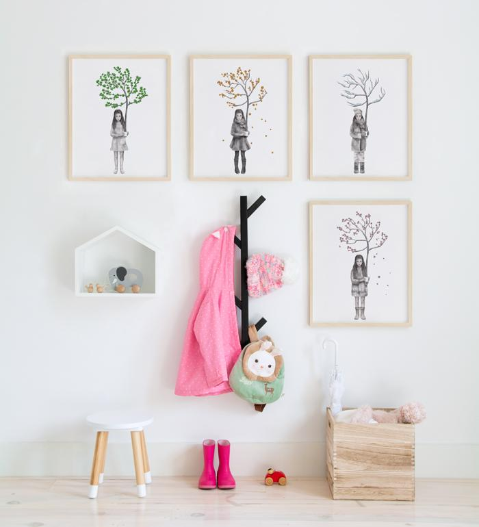 Art Gallery with posters of little girl holding a small tree during the four seasons
