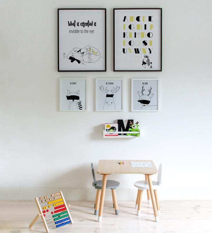 Study area for toddler children with art gallery posters in monochromatic colors