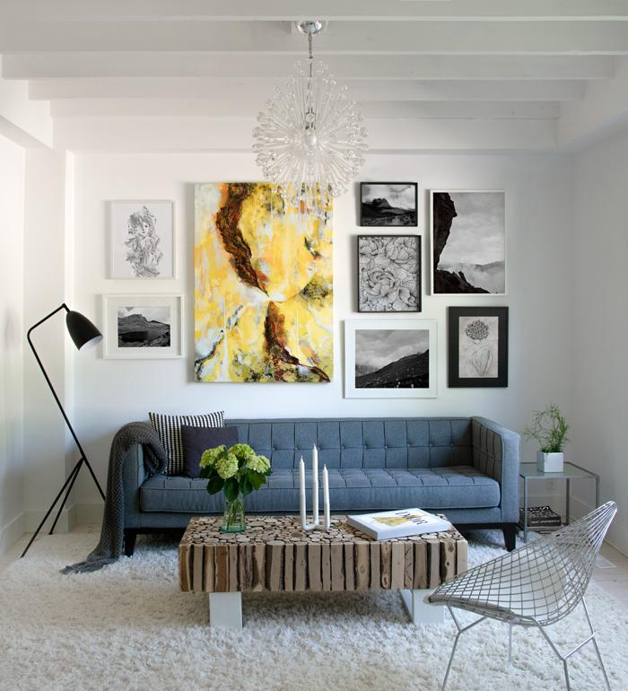 Art Wall in living room with black and white posters and oil color painting