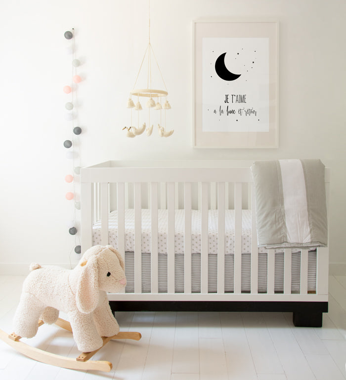 Nursery room with monochrome art print decor
