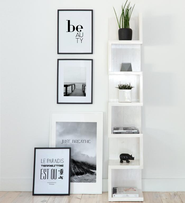 serene art gallery in black & white with photography and typography posters