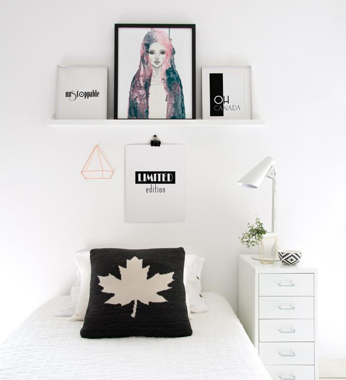 Minimalist teen's bedroom with posters wall decor
