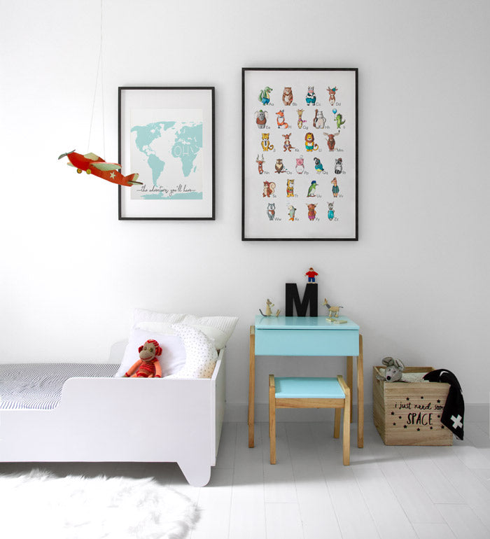Toddler bedroom with cute posters of Alphabet and world map