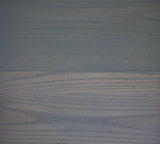 Product shot of General Finishes Gray Gel Stain applied to raw pine.