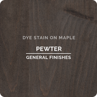 Product shot of General Finishes Pewter Dye Stain applied to raw maple.