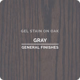 Product shot of General Finishes Gray Gel Stain applied to raw oak.