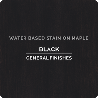 Product shot of General Finishes Black Wood Stain applied to raw maple.