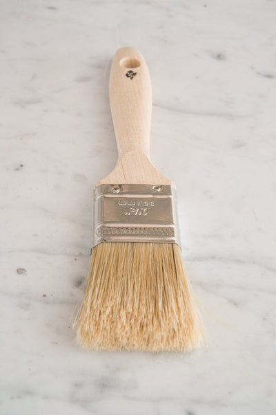 "Miss Mustard Seed's 1.5"" Natural Bristle Brush on counter."