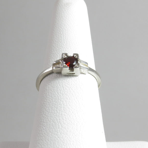 Embrace Ring with Amber Garnet