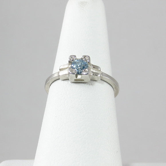Embrace Ring with Blue Topaz