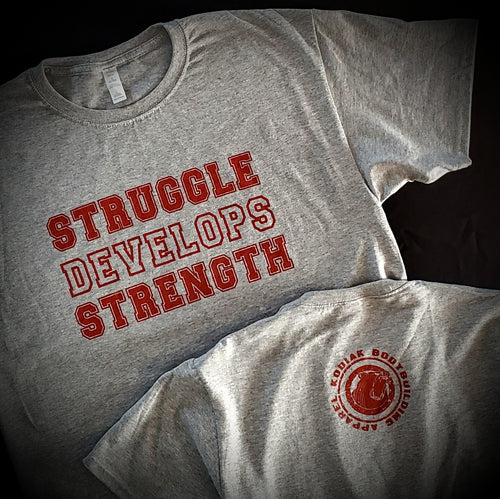 Struggle Develops Strength Tee