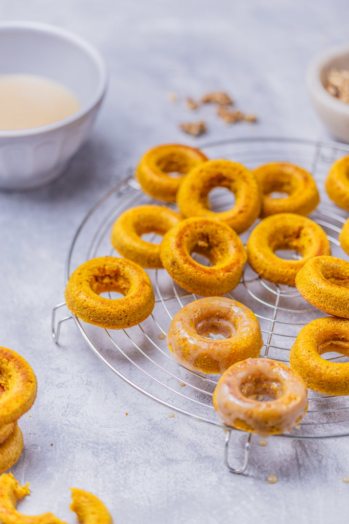 Turmeric carrot donuts with chai spiced glaze