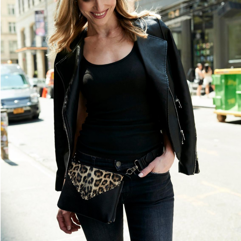 woman wearing a black leopard belt bag by Piper Noble