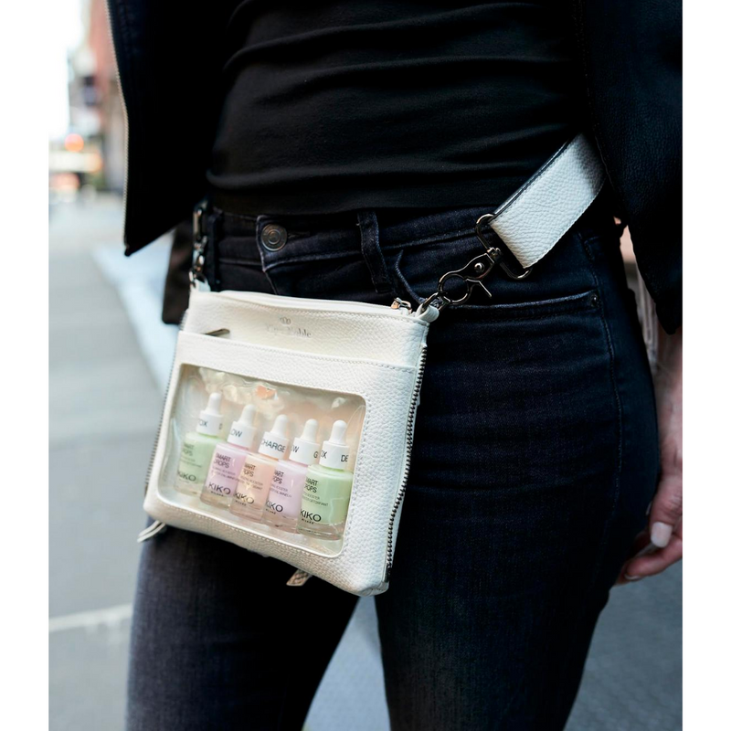 woman wearing a white display belt bag by Piper Noble