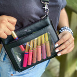 woman displaying her lipsense in a black display belt bag by Piper Noble