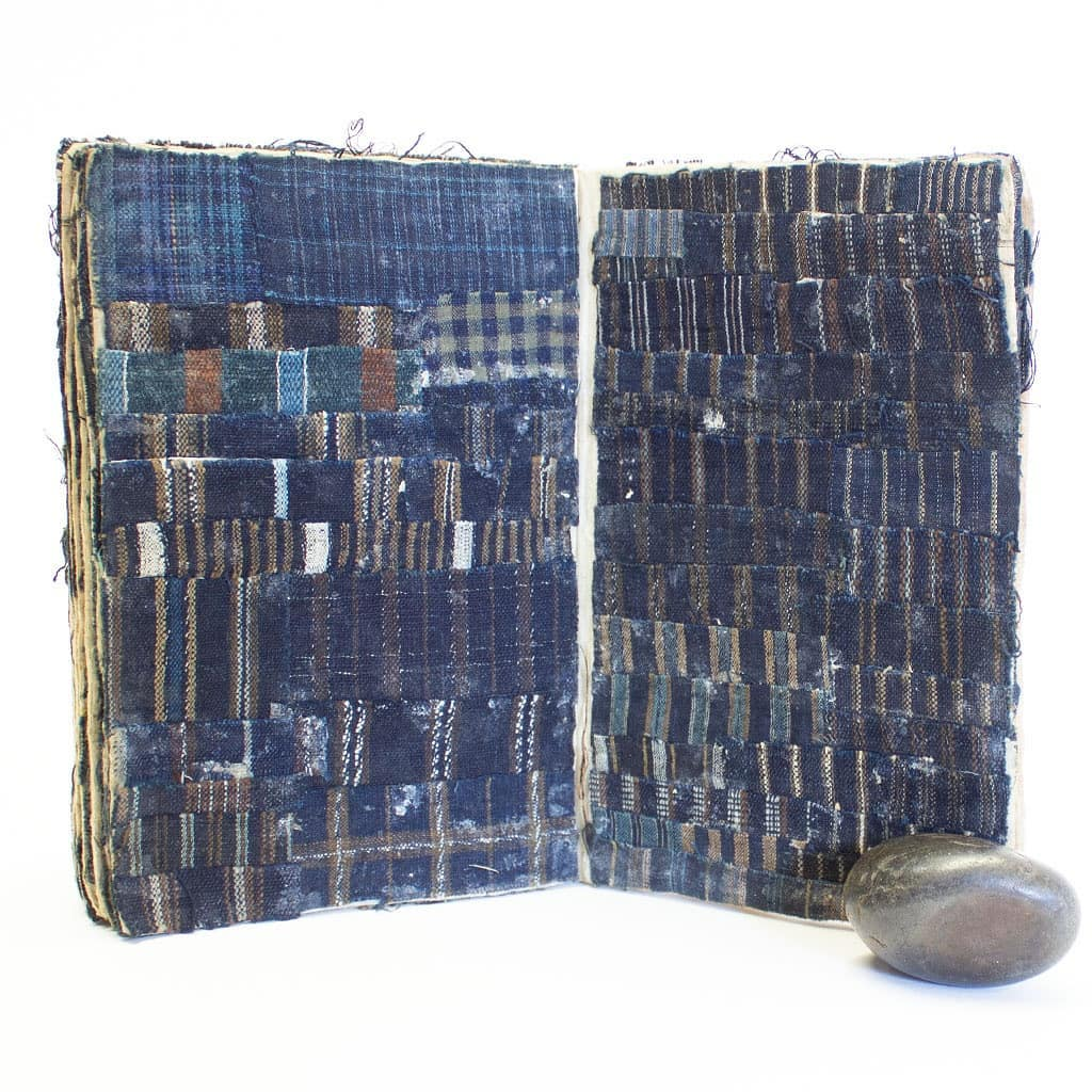 Sample book of indigo fabric