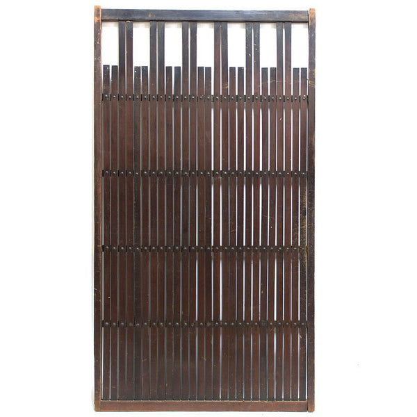 wooden door with thin slats and rivets