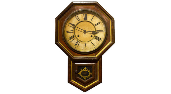 octagonal clock with projection for pendulum