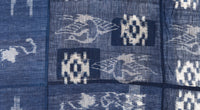 closeup of crane pattern on indigo