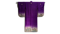 back of purple kimono with family crests and painted scene on hems