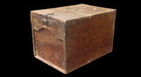 right side of brown box with lid and lock