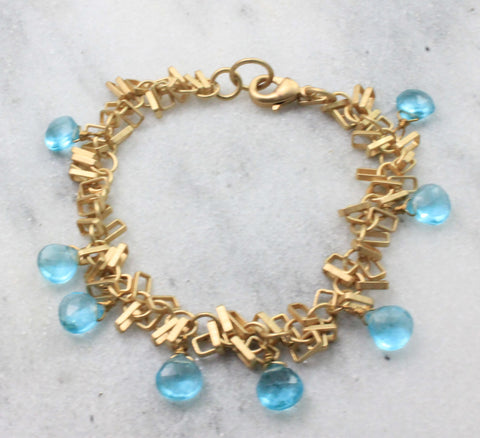 Dangly bracelet with light blue briolettes