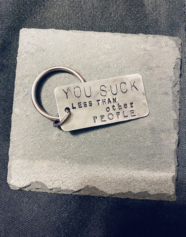 Large keychain- 'you suck less than other people'