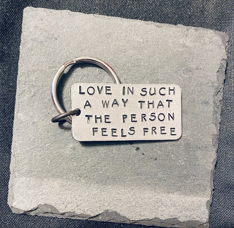 large keychain- 'love in such a way that the other person feels free ' dogtag