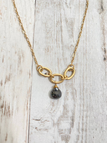 necklace matte gold on triple link. Black spinel