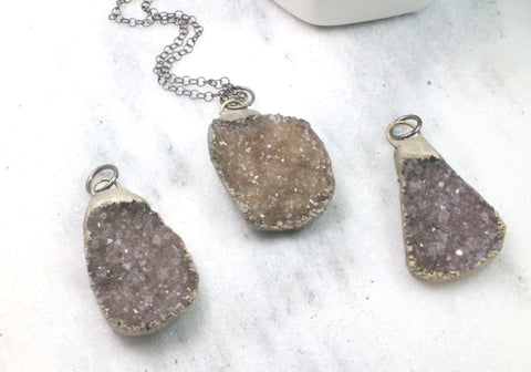 3 large natural druzy pendants.