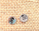 Set of 2 stud earrings. Skulls and evil eye