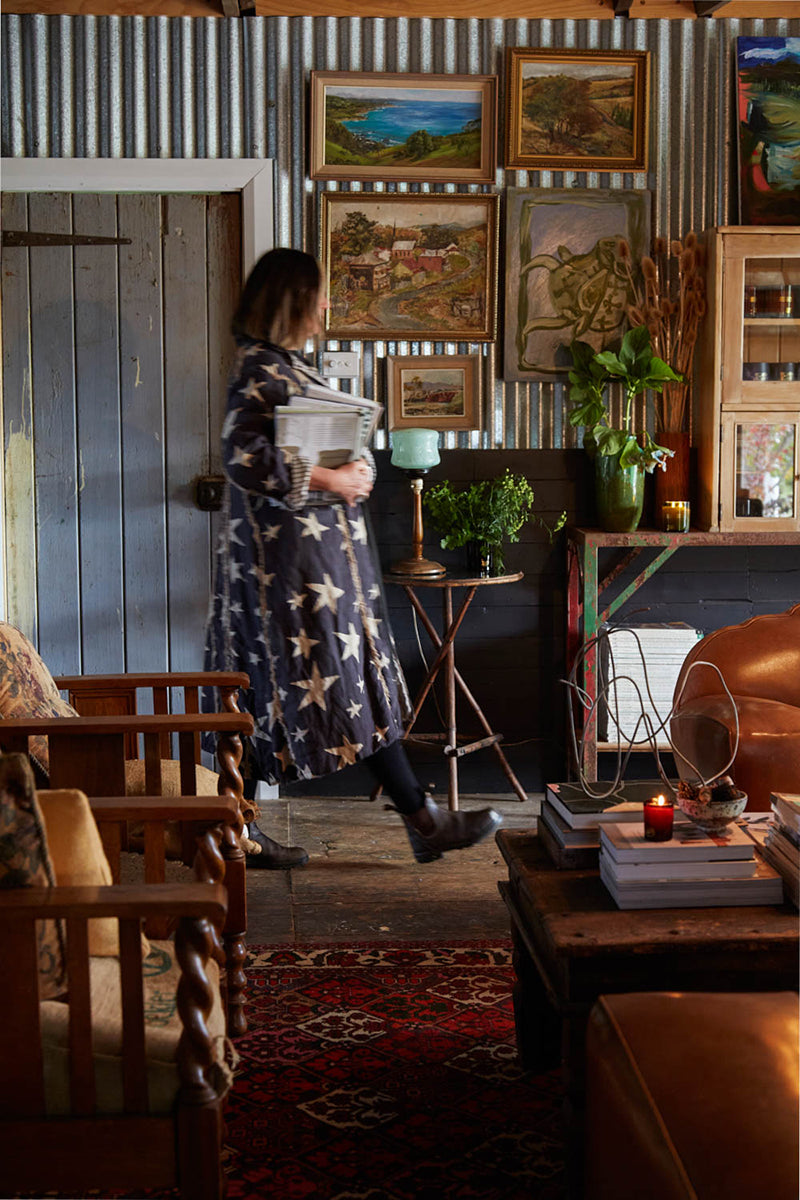 An image of a renovated shearing shed full of australian art, books and Australian made scented candles