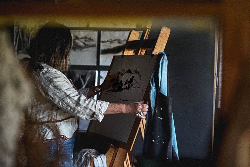 Southern Wild Co founder, Tania Robinson works on a charcoal landscape piece in her converted shearing shed