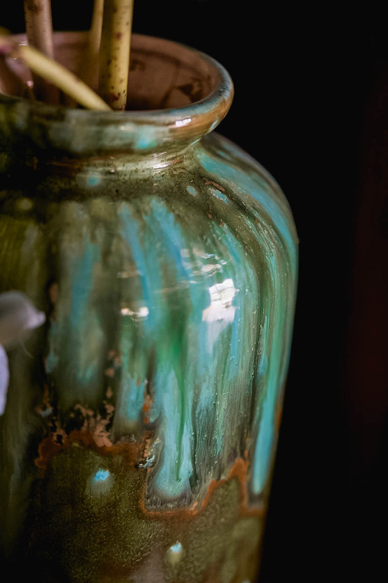 A vintage 1920s vase in beautiful turquoise and rust colours