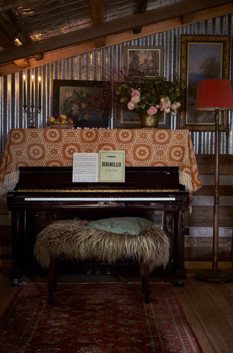 Piano in a vintage interior with antiques