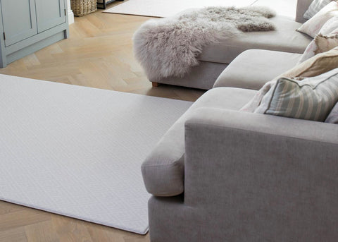 Totter and tumble Playmat, in family room, neutral interiors