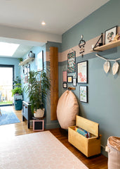 Playroom inspiration in open play living, oval room blue