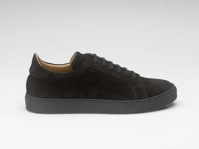 black suede sneakers with black rubber soles