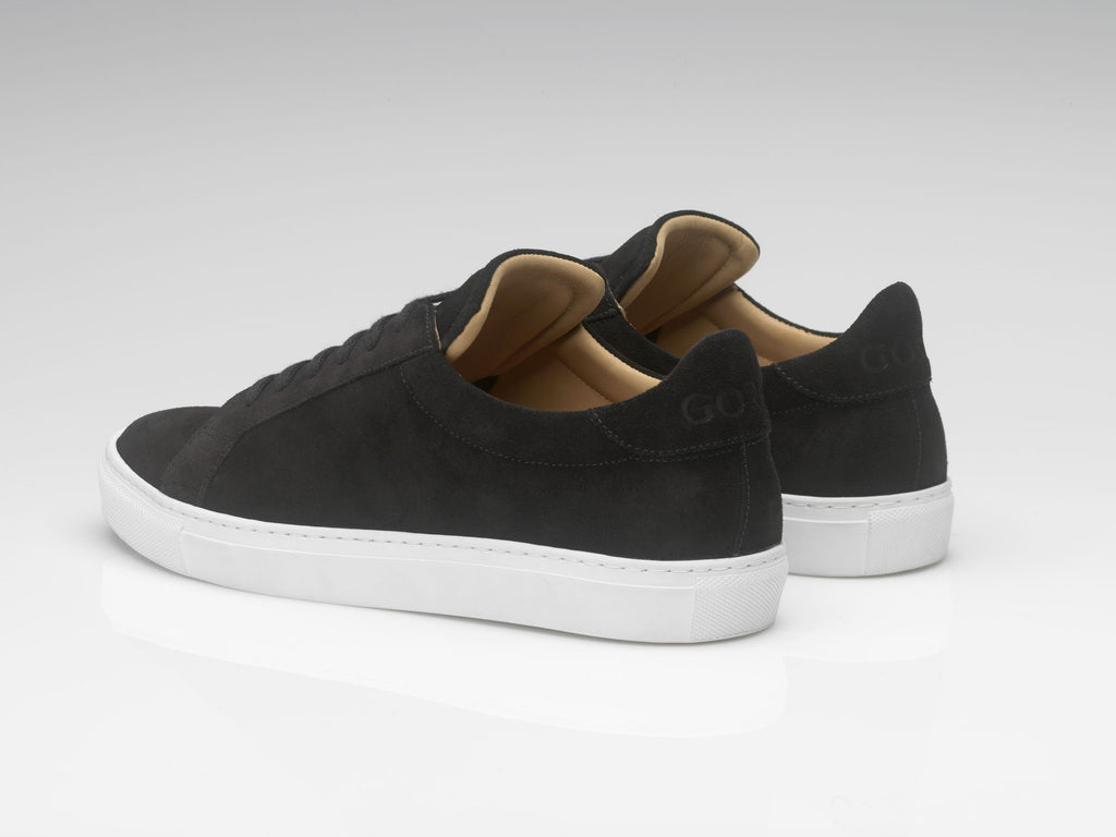 black suede sneakers with white rubber soles