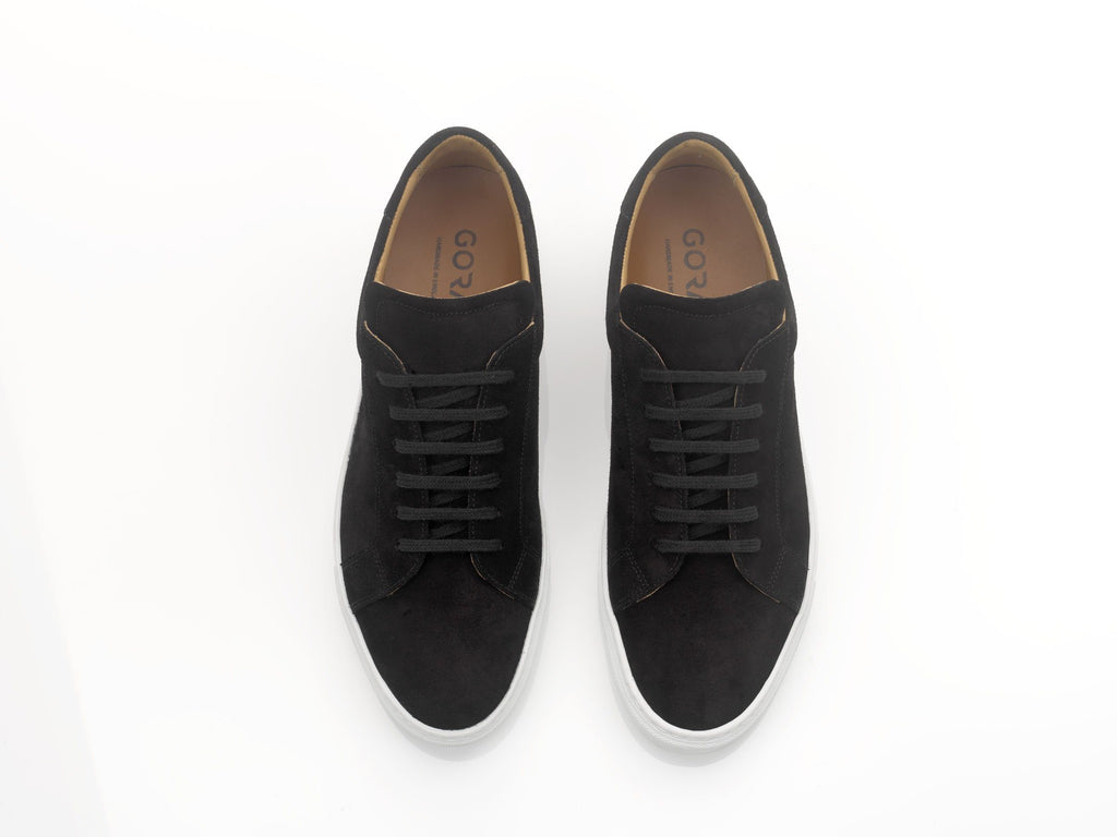 black suede sneakers with white soles