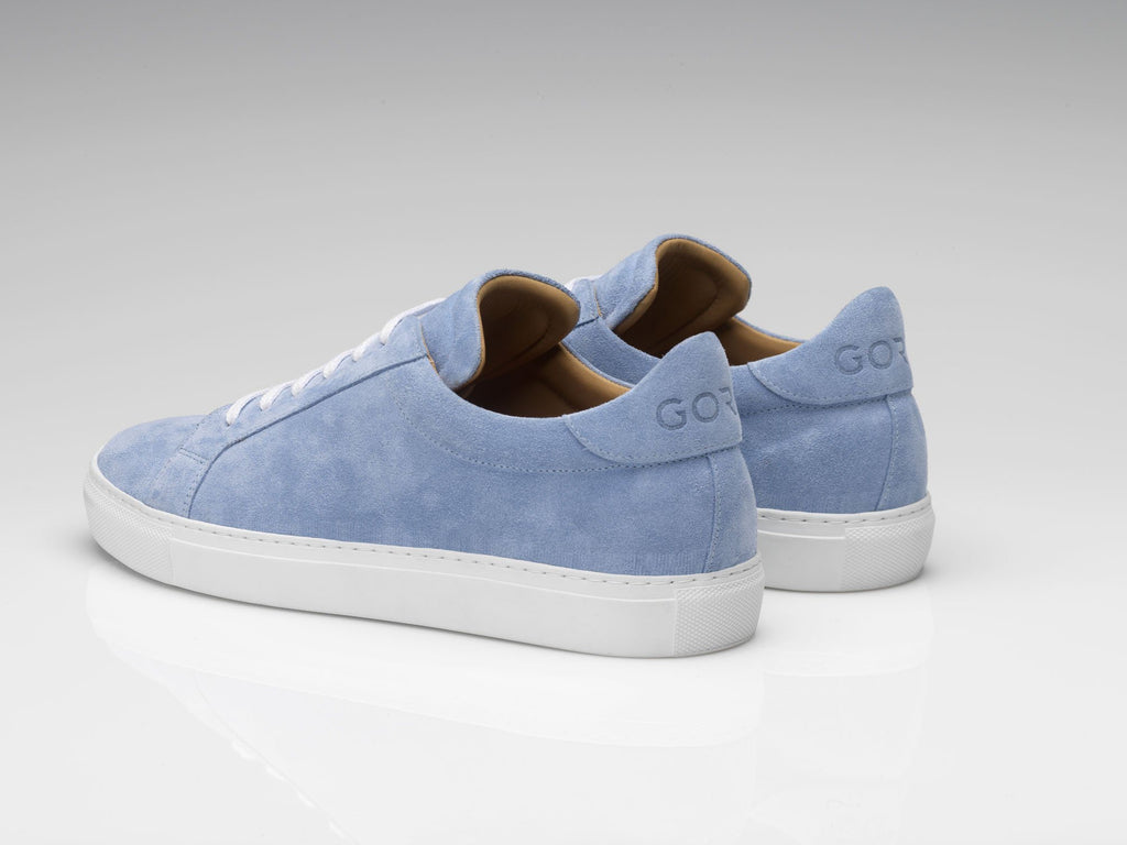 blue suede sneakers with white soles