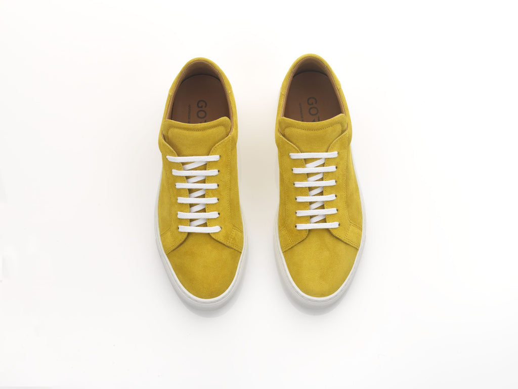 yellow suede sneakers with white rubber soles