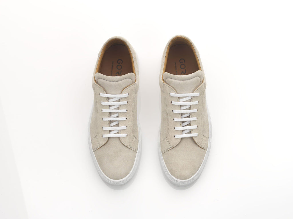 mens off-white suede sneakers with white rubber soles