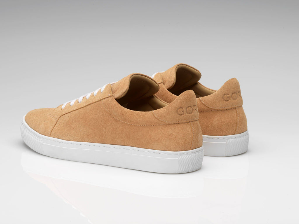 peach suede sneakers with white rubber soles