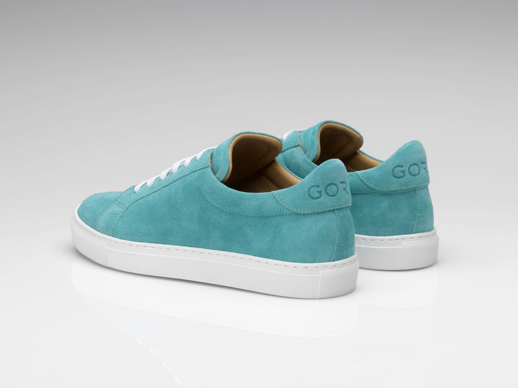 blue suede sneakers with white rubber soles